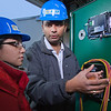 "Graduate students Lisa Stowell and Yamshi Avadhanula work on newly installed equipment in the UAF power plant designed to help capture heat generated by diesel engines.  <div class=""ss-paypal-button"">Filename: AAR-11-3245-146.jpg</div><div class=""ss-paypal-button-end"" style=""""></div>"