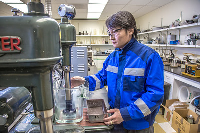 UAF graduate student Purevbaatar Narantsetseg works with samples of rare earth minerals in a Duckering Building lab. Narantsetseg is part of a partnership between UAF and the Mongolian government to establish a school of mining engineering there to educate locals to help develop the country's mineral resources.  Filename: AAR-13-3842-88.jpg