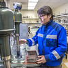 "UAF graduate student Purevbaatar Narantsetseg works with samples of rare earth minerals in a Duckering Building lab. Narantsetseg is part of a partnership between UAF and the Mongolian government to establish a school of mining engineering there to educate locals to help develop the country's mineral resources.  <div class=""ss-paypal-button"">Filename: AAR-13-3842-88.jpg</div><div class=""ss-paypal-button-end"" style=""""></div>"