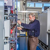 "Research technician David Light works with the battery bank in one of the modules in the Alaska Center for Energy and Power Technology Center.  <div class=""ss-paypal-button"">Filename: AAR-12-3479-043.jpg</div><div class=""ss-paypal-button-end"" style=""""></div>"