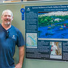 "Undergraduate fisheries major Mark Evans stands with his poster during UAF's Research Day Poster Session in Wood Center.  <div class=""ss-paypal-button"">Filename: AAR-14-4169-59.jpg</div><div class=""ss-paypal-button-end""></div>"