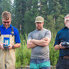 "Personnel with the U.S. Fish and Wildlife Service and the Alaska Center for Unmanned Aircraft Systems Integration (ACUASI) collect video from a camera mounted to an unmanned aerial vehicle flying above a stretch of the upper Chena River in a joint effort to protect the important king salmon spawning habitat.  <div class=""ss-paypal-button"">Filename: AAR-15-4593-346.jpg</div><div class=""ss-paypal-button-end""></div>"