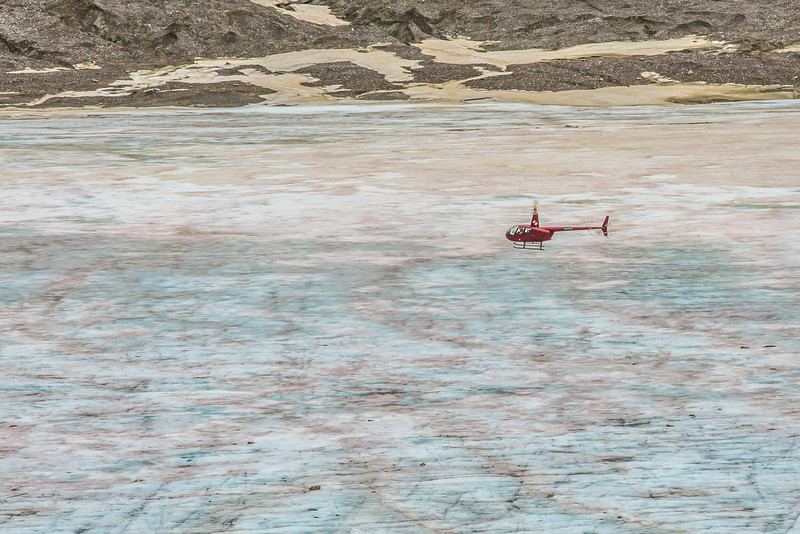 "A helicopter provides access for a team of UAF researchers gathering data from the surface of the Jarvis Glacier in the eastern Alaska Range.  <div class=""ss-paypal-button"">Filename: AAR-14-4256-330.jpg</div><div class=""ss-paypal-button-end""></div>"
