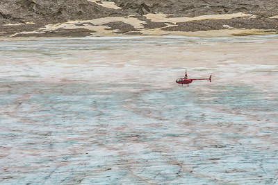 A helicopter provides access for a team of UAF researchers gathering data from the surface of the Jarvis Glacier in the eastern Alaska Range.  Filename: AAR-14-4256-330.jpg
