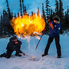 "Research Associate Professor Katey Walter Anthony and a research assistant set fire to escaping methane gas trapped beneath the ice on a pond on the UAF campus. The naturally occurring phenomenon is made worse by thawing permafrost and increased plant decay caused by global warming.  <div class=""ss-paypal-button"">Filename: AAR-16-4815-03.jpg</div><div class=""ss-paypal-button-end""></div>"