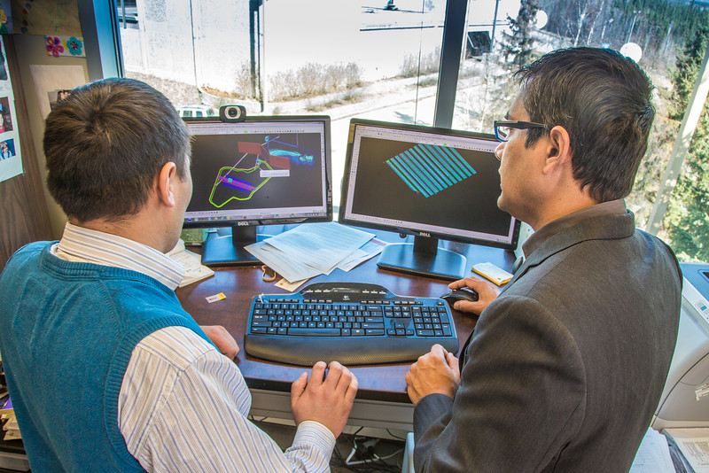 "Prof. Rajive Ganguli, right, works with mineral engineering graduate student Erdenebaatar Dondov to study software models of hard rock mine design in his Duckering Building office. Ganguli is helping Dondov and the government in his home country of Mongolia to establish a school of mining engineering there to educate locals to help develop the country's mineral resources.  <div class=""ss-paypal-button"">Filename: AAR-13-3842-30.jpg</div><div class=""ss-paypal-button-end"" style=""""></div>"