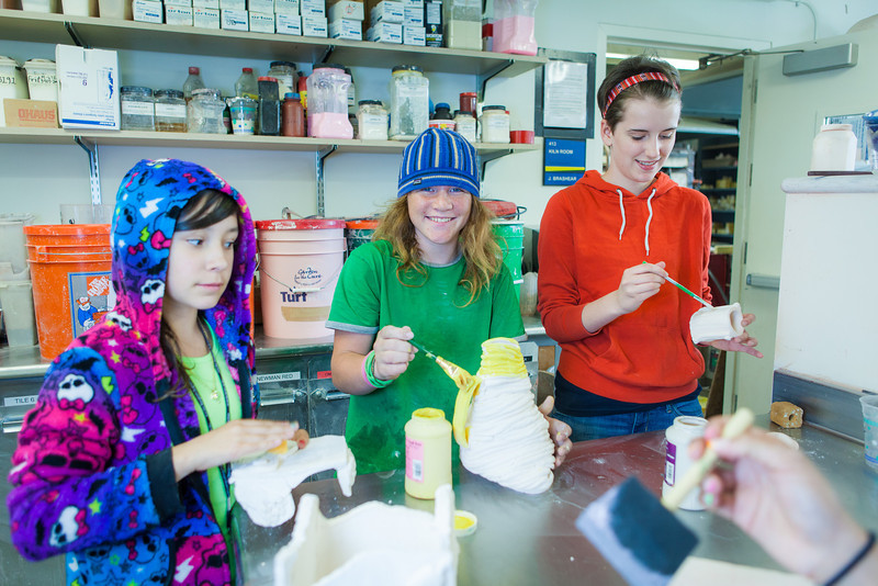 """Students from the Visual Art Academy glaze their artwork during ceramics class.  <div class=""""ss-paypal-button"""">Filename: AAR-13-3860-82.jpg</div><div class=""""ss-paypal-button-end"""" style=""""""""></div>"""