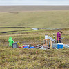 "Ludda Ludwig, right, a Ph.D. candidate with UAF's College of Natural Science and Mathematics, transfers data from a climate recording station at a research site near the headwaters of the Kuparuk River on Alaska's North Slope. Ludwig's research involves the movement of water and nutrients from Arctic hillslopes to streams. Her research partner is Kelsey Blake, in green, a graduate student at the University of Victoria in British Columbia.  <div class=""ss-paypal-button"">Filename: AAR-14-4217-105.jpg</div><div class=""ss-paypal-button-end""></div>"