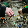 """Children play with dinosaurs and toy machines during the Science Potpourri at the Reichardt  Building.  <div class=""""ss-paypal-button"""">Filename: AAR-14-4141-39.jpg</div><div class=""""ss-paypal-button-end""""></div>"""