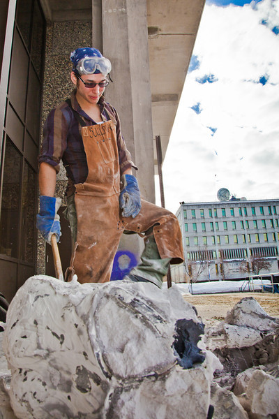 "Art major Joel Isaak stands over the rubble of the plaster cast covering pieces of cooling bronze he'll use to build a life-sized sculpture for his senior thesis.  <div class=""ss-paypal-button"">Filename: AAR-12-3341-19.jpg</div><div class=""ss-paypal-button-end"" style=""""></div>"