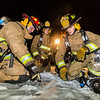 "UFD Captain Forrest Kuiper, left, gives instructions to student firefighters during a live drill at the Fairbanks International Airport.  <div class=""ss-paypal-button"">Filename: AAR-13-3995-36.jpg</div><div class=""ss-paypal-button-end"" style=""""></div>"