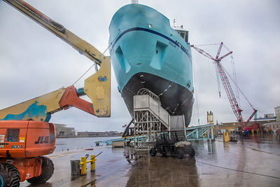 The R/V Sikuliaq starts to slide off its mount and into the water during its launch at the Marinette Marine Corp. in Marinette, Wisc.  Filename: AAR-12-3594-137.jpg