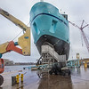"""The R/V Sikuliaq starts to slide off its mount and into the water during its launch at the Marinette Marine Corp. in Marinette, Wisc.  <div class=""""ss-paypal-button"""">Filename: AAR-12-3594-137.jpg</div><div class=""""ss-paypal-button-end"""" style=""""""""></div>"""