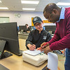 "UAF Chukchi Campus Assistant Professor of Developmental Math Kelechukwu Alu works one-on-one with a student during a morning class at the Alaska Technical Center in Kotzebue.  <div class=""ss-paypal-button"">Filename: AAR-16-4863-332.jpg</div><div class=""ss-paypal-button-end""></div>"