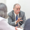 "Associate Professor Mike Davis with UAF's Alaska Native Studies and Rural Development program leads a morning discussion with a group of students from rural Alaska in a weeklong seminar on Understanding the Legislative Process in the state capital of Juneau.  <div class=""ss-paypal-button"">Filename: AAR-14-4054-30.jpg</div><div class=""ss-paypal-button-end"" style=""""></div>"