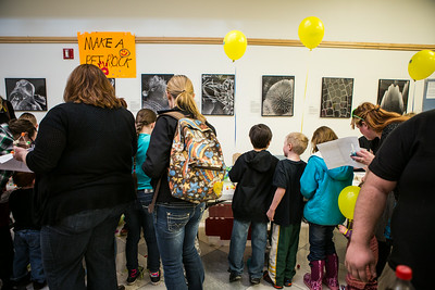 Children line up for a pet rock during Science Potpourri at the Reichardt Building.\  Filename: AAR-14-4141-157.jpg