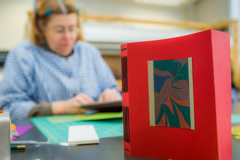 "Students work on their projects in a custom book binding workshop offered by UAF Summer Sessions during Wintermester 2013.  <div class=""ss-paypal-button"">Filename: AAR-13-3706-15.jpg</div><div class=""ss-paypal-button-end"" style=""""></div>"