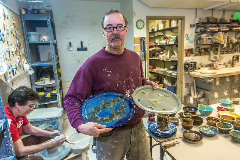 """Local resident Manfred Finger shows off a couple of the creations he made in the ceramics studio at UAF's Kuskokwim Campus in Bethel.  <div class=""""ss-paypal-button"""">Filename: AAR-16-4859-628.jpg</div><div class=""""ss-paypal-button-end""""></div>"""