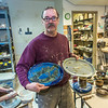 "Local resident Manfred Finger shows off a couple of the creations he made in the ceramics studio at UAF's Kuskokwim Campus in Bethel.  <div class=""ss-paypal-button"">Filename: AAR-16-4859-628.jpg</div><div class=""ss-paypal-button-end""></div>"