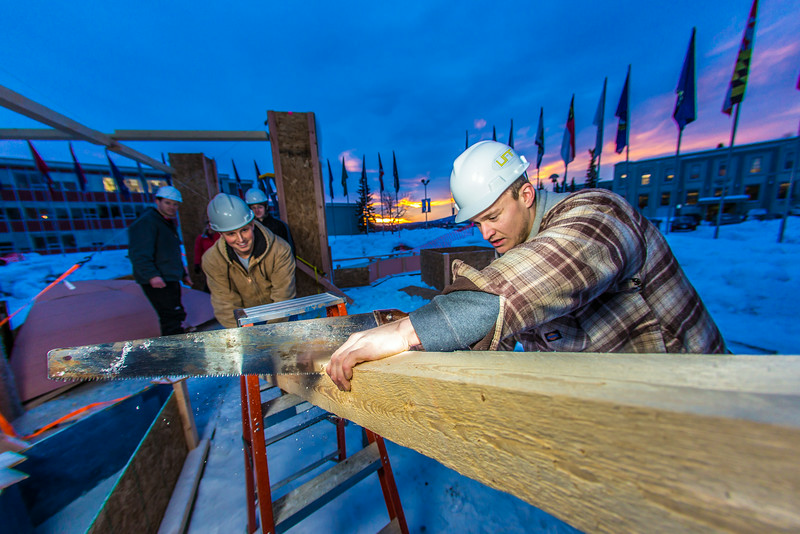 "Engineering students meet on a chilly January morning to work on the 2014 ice arch.  <div class=""ss-paypal-button"">Filename: AAR-14-4043-14.jpg</div><div class=""ss-paypal-button-end""></div>"