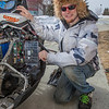 "Mechanical enineering major Isaac Thompson makes some adjustments to the UAF team's snowmobile in front of the Duckering Building after its return from competing in the Society of Automotive Engineers' Clean Snowmobile Challenge in Houghton, Mich.  <div class=""ss-paypal-button"">Filename: AAR-12-3345-015.jpg</div><div class=""ss-paypal-button-end"" style=""""></div>"