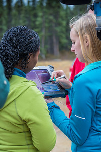 Students take part in a project using unmaned aerial vehicles (UAVs) at Poker Flat Research Range about 40 miles northeast of the Fairbanks campus. (Note: Taken as part of commercial shoot with Nerland Agency. Pretend class -- use with discretion!)  Filename: AAR-12-3560-094.jpg