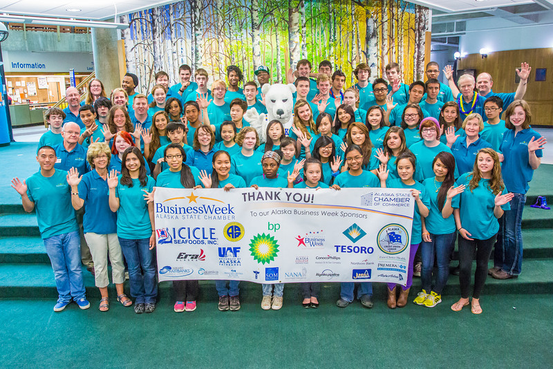 """Students and staff of Alaska Business Week pose with the Alaska Nanook in the Wood Center on the UAF campus. The week-long event is sponsored each summer by UAF's School of Management and the Northern Leadership Center.  <div class=""""ss-paypal-button"""">Filename: AAR-13-3855-19.jpg</div><div class=""""ss-paypal-button-end"""" style=""""""""></div>"""