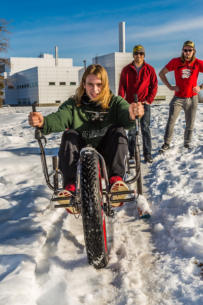 """Mechanical engineering major Daniel Sandstrom operates a fat tire ski bike he and partners Neil Gotschall, left, and Eric Bookless designed and built for paraplegic users as their spring 2016 senior design project. The bike is powered by pushing and pulling on the handles.  <div class=""""ss-paypal-button"""">Filename: AAR-16-4856-59.jpg</div><div class=""""ss-paypal-button-end""""></div>"""