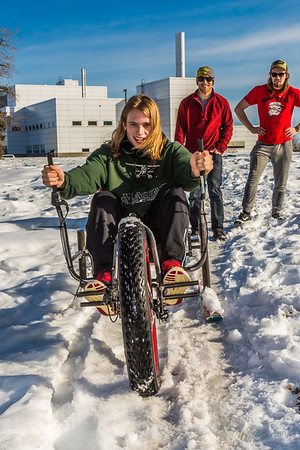 Mechanical engineering major Daniel Sandstrom operates a fat tire ski bike he and partners Neil Gotschall, left, and Eric Bookless designed and built for paraplegic users as their spring 2016 senior design project. The bike is powered by pushing and pulling on the handles.  Filename: AAR-16-4856-59.jpg