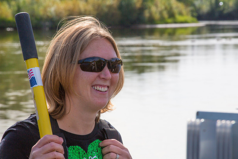 """Fisheries undergraduate student Patty McCall takes a break during a trip to the Chena River to collect samples for a  research project on the life dynamics of Arctic brook lampreys.  <div class=""""ss-paypal-button"""">Filename: AAR-12-3468-002.jpg</div><div class=""""ss-paypal-button-end"""" style=""""""""></div>"""