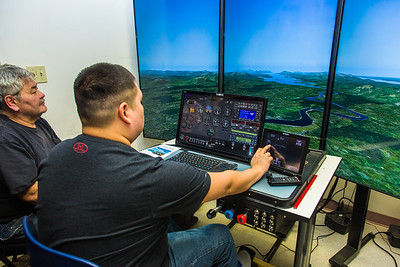 Community members take flight school classes in a state-of-the-art simulator at UAF's Bristol Bay Campus in Dillingham.  Filename: AAR-16-4860-314.jpg