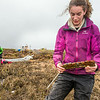 """Ludda Ludwig, a Ph.D. candidate with UAF's College of Natural Science and Mathematics, collects water samples from a research site near the headwaters of the Kuparuk River on Alaska's North Slope.  <div class=""""ss-paypal-button"""">Filename: AAR-14-4217-054.jpg</div><div class=""""ss-paypal-button-end""""></div>"""