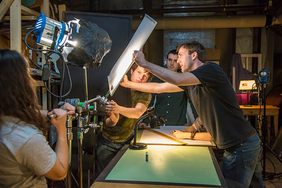 Guest lecturer Dave Selle, right, instructs students on lighting for a scene during the 2013 Wintermester cinematography class in the UAF Fine Arts complex.  Filename: AAR-13-3690-33.jpg