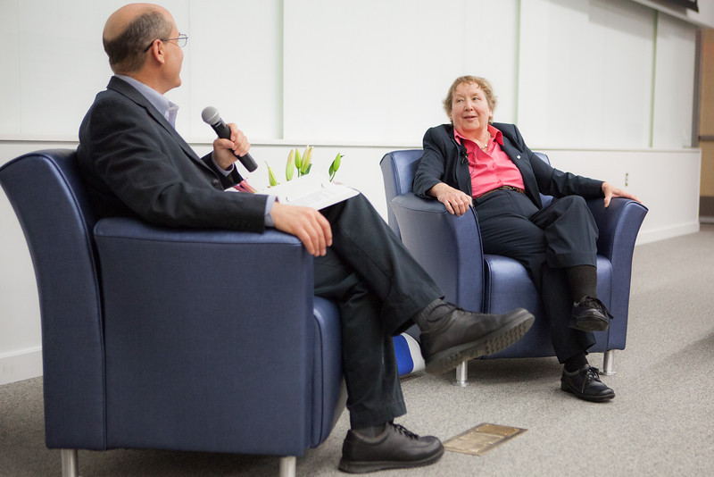 """Host Robert Hannon converses with distinguished alumnus, Vera Alexander, during Summer Sessions' Legacy Lectures at the Murie Building Auditorium.  <div class=""""ss-paypal-button"""">Filename: AAR-13-3852-32.jpg</div><div class=""""ss-paypal-button-end"""" style=""""""""></div>"""