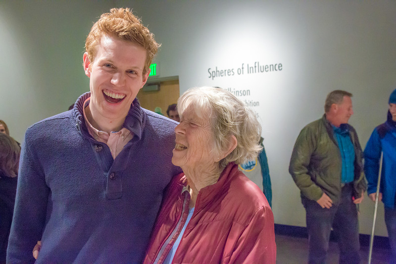 """Art major Ian Wilkinson visits with patrons during the opening reception of his BFA thesis in the gallery of the UAF Fine Arts Complex.  <div class=""""ss-paypal-button"""">Filename: AAR-13-3780-407.jpg</div><div class=""""ss-paypal-button-end"""" style=""""""""></div>"""