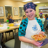 "Ten-year-old Melody Lackey displays the pepperoni pizza she made during the UAF Summer Sessions Baking Blitz May 28 in the Hutchison kitchen.  <div class=""ss-paypal-button"">Filename: AAR-14-4203-68.jpg</div><div class=""ss-paypal-button-end""></div>"
