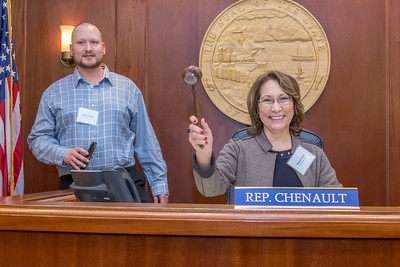 Helen Foster, a senior in UAF's rural development program from Dillingham, has some fun with the gavel moments after posing with Speaker Mike Chenault in the House chambers during a weeklong seminar on understanding the legislative process in Juneau.  Filename: AAR-14-4053-159.jpg