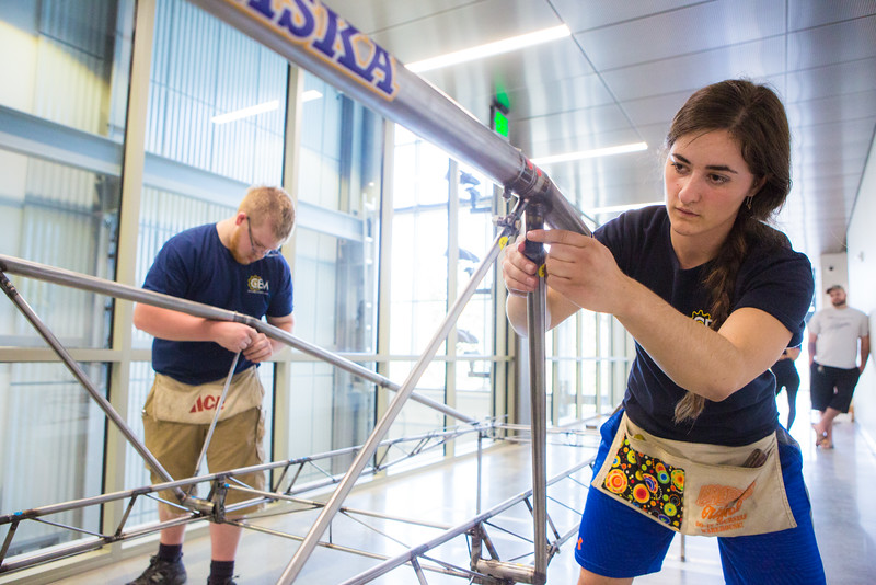 """Catherine Estus adds finishing touches to the 2016 steel bridge model during a practice run in the Duckering Building.  <div class=""""ss-paypal-button"""">Filename: AAR-16-4888-53.jpg</div><div class=""""ss-paypal-button-end""""></div>"""