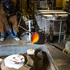 "Art major Joel Isaak, left, fills a mold with molten bronze as part of the process of creating a life-sized sculpture for his senior thesis in the UAF Fine Arts complex.  <div class=""ss-paypal-button"">Filename: AAR-12-3347-102.jpg</div><div class=""ss-paypal-button-end"" style=""""></div>"