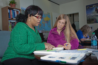 Lauren Divine, right, a tutor with UAF's Student Support Services, works with Sante Lee-Sonkoh during a session in the SSS study lounge in the Gruening Building.  Filename: AAR-12-3285-043.jpg