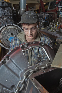 George Jensen disassembles a transmission in the diesel mechanics lab at the Hutchison Institute of Technology.  Filename: AAR-12-3312-044.jpg