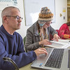"Assistant professor Brian Edmonds, left,  works with undergraduates Arianna Demmerly and Courtney Sessum in a Reichardt Building study lounge.  <div class=""ss-paypal-button"">Filename: AAR-12-3598-097.jpg</div><div class=""ss-paypal-button-end"" style=""""></div>"