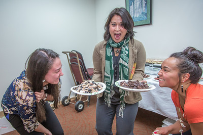 Assistant Professor Barbara Blake, center, tries to protect plates of muktuk from two hungry students while setting up a potluck at Juneau's Goldbelt Hotel this week. Sarah Walker, left, Kelsey Wallace, right, and other students participated in a week-long seminar on the legislative process. The seminar was offered by UAF's Department of Alaska Native Studies and Rural Development, where Blake teaches.  Filename: AAR-14-4055-396.jpg