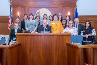 Speaker of the Alaska House of Representatives Mike Chenault poses with students and staff from Prof. Mike Davis's rural development leadership seminar during their week-long workshop in Juneau.  Filename: AAR-14-4053-144.jpg