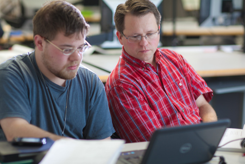 """Assistant professor Thane Magelky, right, works with freshman James Griffin in his drafting technology class in the CTC center downtown.  <div class=""""ss-paypal-button"""">Filename: AAR-11-3221-35.jpg</div><div class=""""ss-paypal-button-end"""" style=""""""""></div>"""