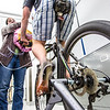 "Ivan Lien works out on his bicycle while Marisol Bastiani helps collect data measuring his respiration during a human physiology lab in the Murie Building.  <div class=""ss-paypal-button"">Filename: AAR-13-3983-70.jpg</div><div class=""ss-paypal-button-end"" style=""""></div>"