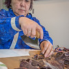 "Molly Jacobson, a senior in UAF's rural development program from Bethel, chops pieces of caribou jerkey before a potluck dinner hosted by students during a weeklong seminar on understanding the legislative process. Several state legislators and other officials attended the event at the Goldbelt Hotel in Juneau.  <div class=""ss-paypal-button"">Filename: AAR-14-4055-359.jpg</div><div class=""ss-paypal-button-end"" style=""""></div>"