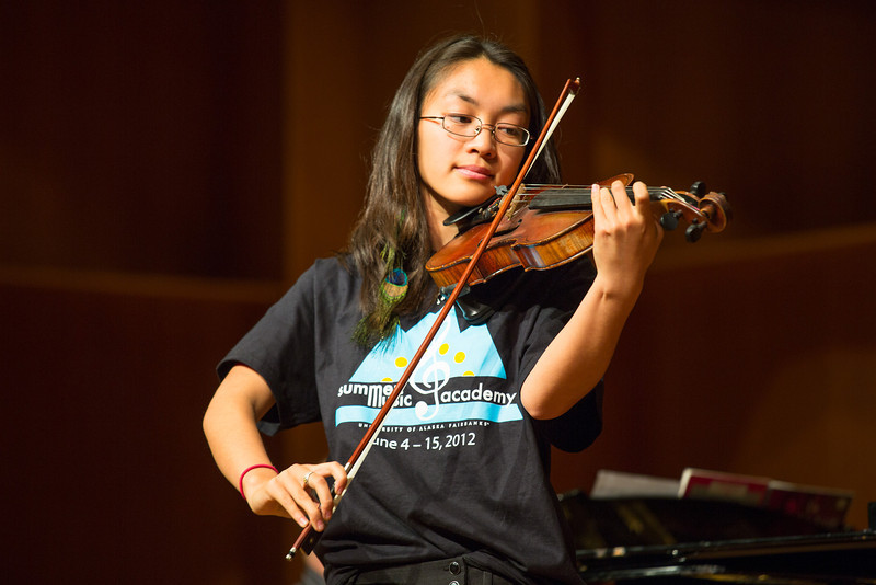 """Rose Crelli performs a piece by Mozart/Kreisler on violin during UAF's Summer Music Academy's daily Concert hour performances at the Davis Concert Hall.  <div class=""""ss-paypal-button"""">Filename: AAR-12-3429-14.jpg</div><div class=""""ss-paypal-button-end"""" style=""""""""></div>"""