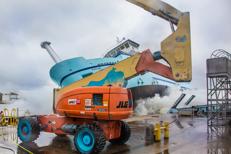 """The R/V Sikuliaq splashes into the water during its launch at the Marinette Marine Corp. in Marinette, Wisc.  <div class=""""ss-paypal-button"""">Filename: AAR-12-3594-139.jpg</div><div class=""""ss-paypal-button-end"""" style=""""""""></div>"""