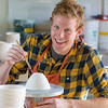 """Art major Ian Wilkinson works on one of the approximately 1,000 ceramic bowls needed for his senior thesis project in the fine arts complex on the Fairbanks campus.  <div class=""""ss-paypal-button"""">Filename: AAR-12-3547-110.jpg</div><div class=""""ss-paypal-button-end"""" style=""""""""></div>"""